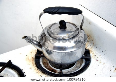 hot water kettle on the stove - stock photo
