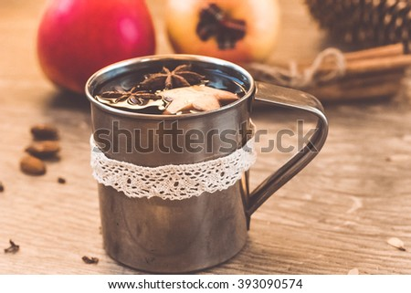 Hot wine for winter and Christmas with various spices - stock photo