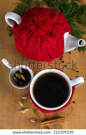 Hot winter tea with spices, top view - stock photo