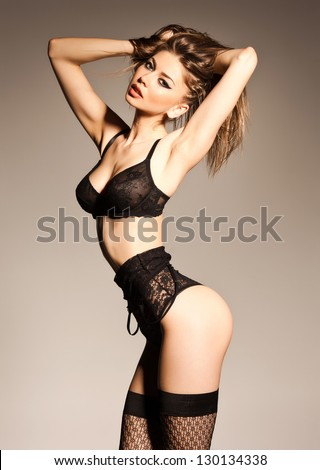 hot woman in lingerie with sexy body posing glamorous in the studio - stock photo