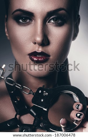 hot woman with handcuffs - stock photo