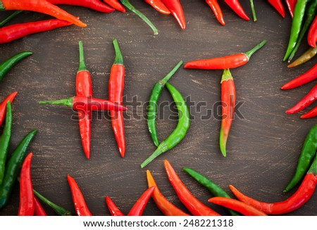 Hot word made from red and green hot chili pepper - stock photo