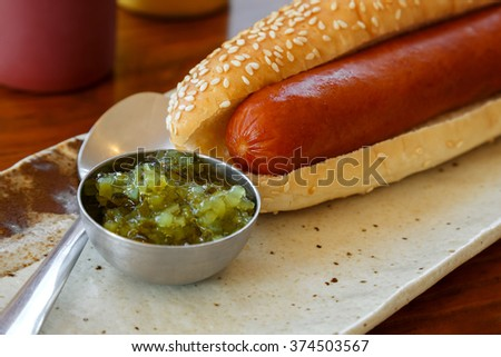 Hotdog with a Big Sausage in a Plate on a Table