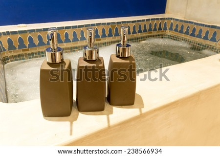 hotel amenities kit spa, soap and shampoo in vintage bathroom - stock photo