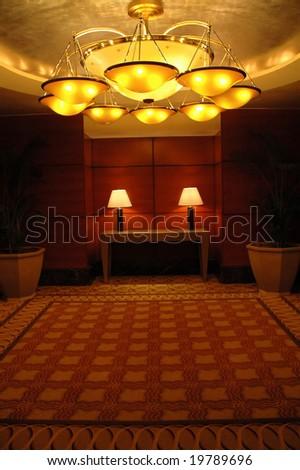 hotel ballroom and grand chandelier - stock photo