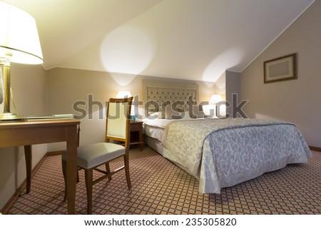 Hotel bedroom interior - stock photo