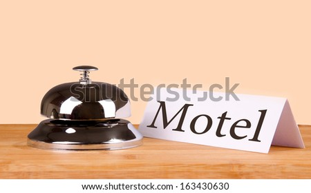 Hotel bell at the table. Isolated background.