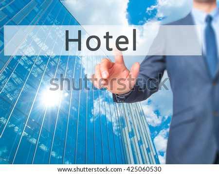 Hotel - Businessman hand pressing button on touch screen interface. Business, technology, internet concept. Stock Photo - stock photo