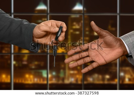 Hotel clerk gives car key. Office employee receives car key. Moving with comfort. Finally getting the key back. - stock photo