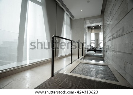 Hotel corridor to swimming pool.