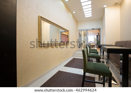 Hotel corridor with bar stools and tables