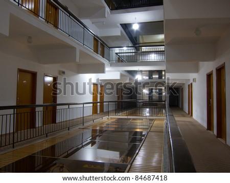 Hotel corridor with doors and handrail - stock photo