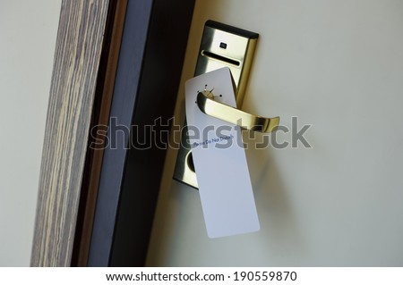 Hotel door handle with a do not disturb sign - stock photo