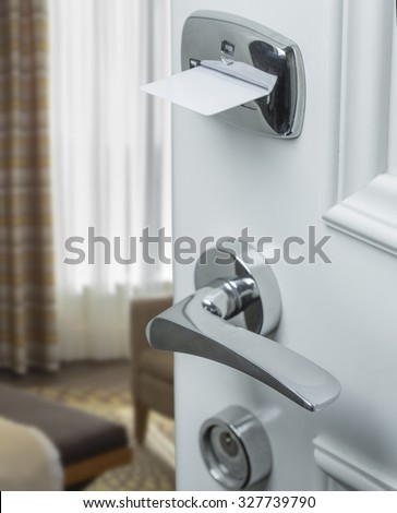 Hotel door with magnetic lock macro - stock photo