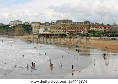 """Hotel du Palais in Biarritz, France. This red hotel also known as """"Villa Eugenie""""  is located on the beach of Biarritz (Grande Plage) where the most important surf events of Europe take place. - stock photo"""