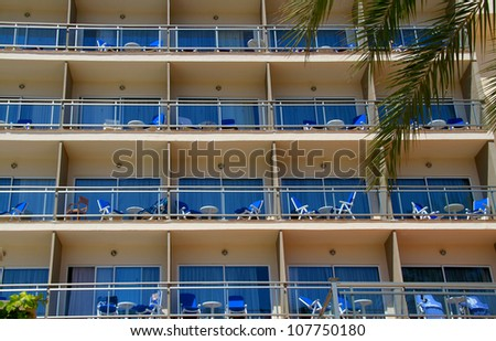 Hotel front with identical balconies - stock photo