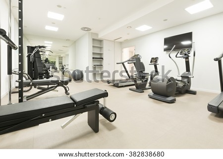 Hotel gym interior with equipment