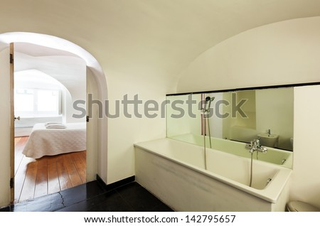 hotel in historic palace, interior, view bedroom from bathroom