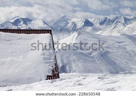 Hotel in snow and ski slope. Caucasus Mountains, Georgia, ski resort Gudauri. - stock photo