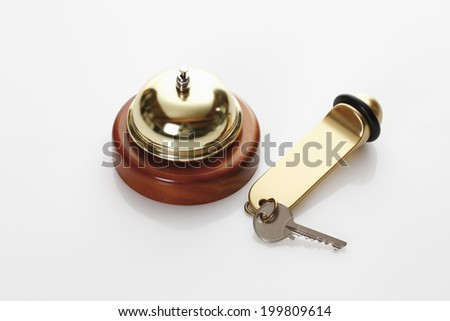 Hotel key and service bell - stock photo