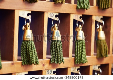 hotel keys with green tassels at reception desk counter - stock photo