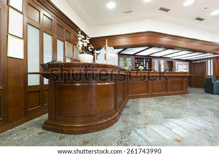 Hotel lobby with reception desk - stock photo