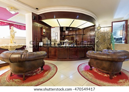 Hotel lobby with wooden reception desk