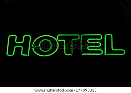 Hotel neon sign with black background