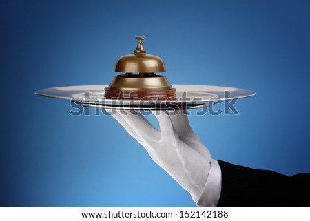 Hotel reception service bell on a silver tray concept for assistance and support - stock photo