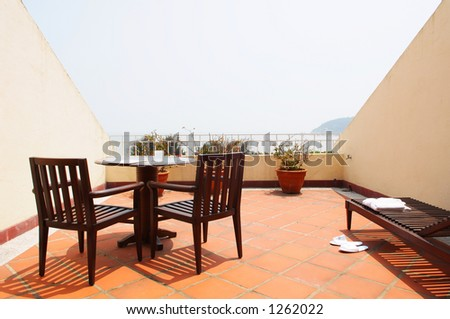 hotel resort room with balcony facing the sea - stock photo