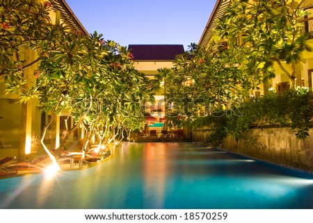 Hotel resort with pool in the middle under magnolia trees - stock photo