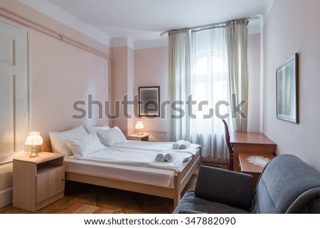 Hotel room interior with double bed - stock photo