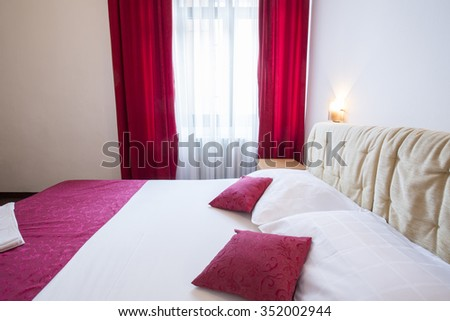 Hotel room interior with two beds