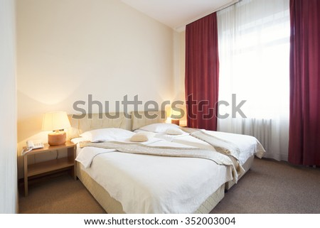 Hotel room interior with two beds - stock photo