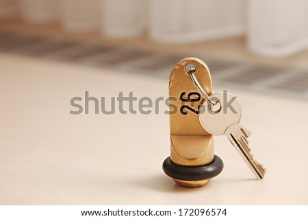 Hotel room key on a table - stock photo