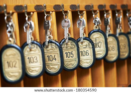 hotel room keys at reception desk counter - stock photo