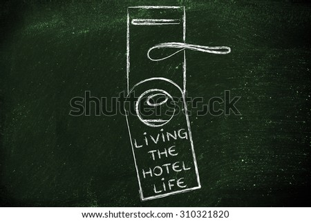 hotel room lock with door hanger saying Living the Hotel Life - stock photo
