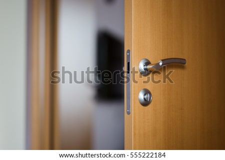 Hotel room or apartment doorway with open door
