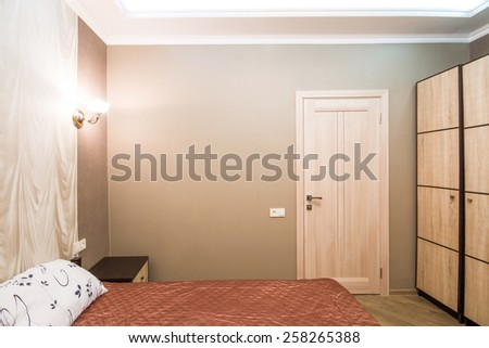 Hotel room. Small bedroom with double bed. Modern interior room
