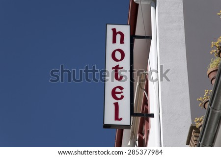 Hotel Sign against Blue Sky Background