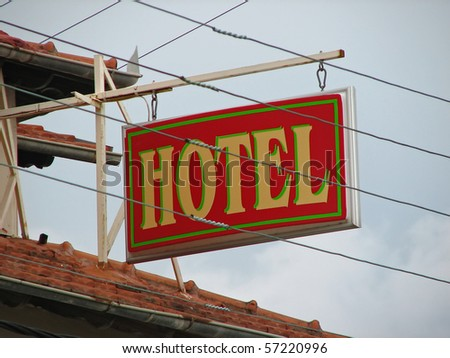 hotel sign. flashing sign. hotel advertise. - stock photo