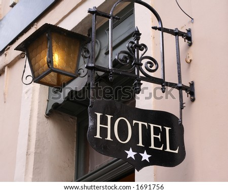 Hotel sign for a two star hotel - stock photo