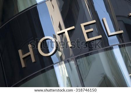 Hotel Sign in Urban Setting - stock photo