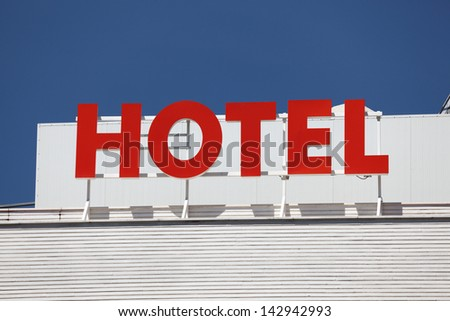 Hotel sign on top of a building