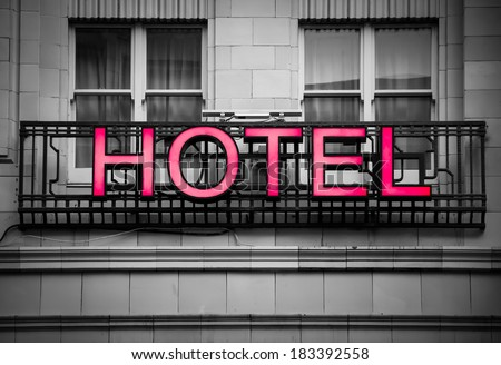 hotel signboard in a building facade - stock photo