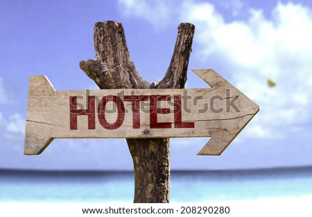 Hotel wooden sign with a beach on background  - stock photo