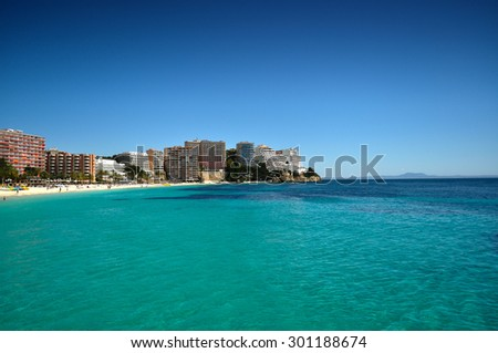 Hotels on the shore of the beach, seen from the sea - stock photo