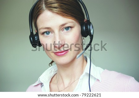 Hotline – Young attractive woman at work - stock photo