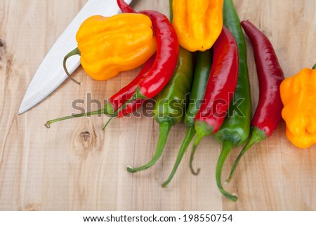 Hottest peppers on a table - stock photo