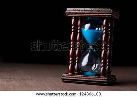 hourglass clock on black background